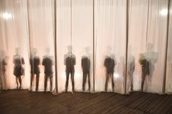 The silhouette of the men behind the curtain in the theater on stage, the shadow behind the scenes is similar to the white and bla royalty free stock images