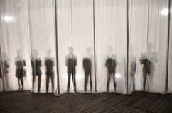 The silhouette of the men behind the curtain in the theater on stage, the shadow behind the scenes is similar to the white and bla royalty free stock photography