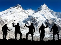 Silhouette of men with ice axe in hand, Mount Everest Royalty Free Stock Photos