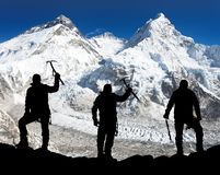Silhouette of men with ice axe in hand, Mount Everest Royalty Free Stock Image