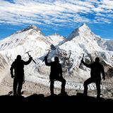 Silhouette of men with ice axe in hand, Mount Everest Royalty Free Stock Photography