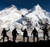 Silhouette of men with ice axe in hand, Mount Everest Stock Photography
