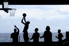 Silhouette of Men Playing Basketball Royalty Free Stock Photography