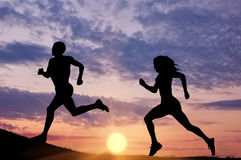 Silhouette men and women runners-up Royalty Free Stock Photos