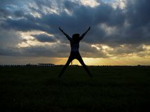Silhouette. Men or women show joy in success at work. Royalty Free Stock Photography
