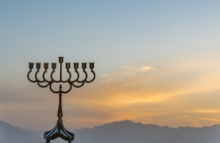 Silhouette of menorah for Hanukkah Jewish holiday symbol. Menorah is a traditional Jewish attributes for Hanukkah holiday. Selective focus Royalty Free Stock Photography