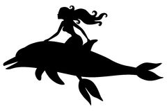 Silhouette of a mermaid riding a dolphin Royalty Free Stock Image