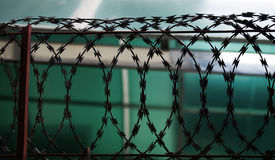 SILHOUETTE METAL RAZOR WIRE FENCING Royalty Free Stock Photography