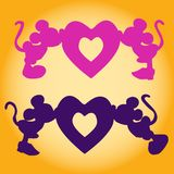 Silhouette of Mickey Mouse boy and girl kiss the heart, an ill. Ustration for Valentine`s Day on a yellow background Stock Photos