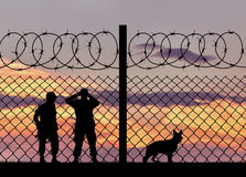 Silhouette of the military with a dog Stock Photography