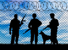 Silhouette of the military and the dog stock image