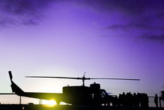 Silhouette of a military helicopter on a mission Royalty Free Stock Images