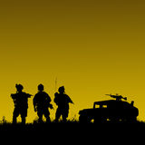 Silhouette of military soldiers team or officer with weapons and Royalty Free Stock Images