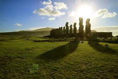 Silhouette of Moai statues against dazzling sunrise sky at Ahu Tongariki, the largest celemonial platform on Easter Island, Chile. South America stock image