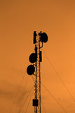 Silhouette mobile antenna tower Stock Images