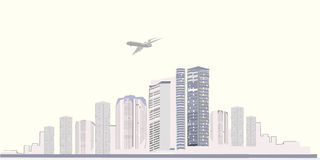 Silhouette of a modern city. With a plane flying over it Royalty Free Stock Image