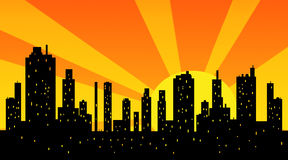 Silhouette of modern city at sunset Stock Images