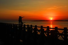 Probolinggo indonesia. July 6, 2016. Silhouette of the sun rises on the beach. Silhouette moment at sunset makes more dramatic a more object royalty free stock images