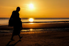 Silhouette of monk walk on the beach , Huahin Royalty Free Stock Photo