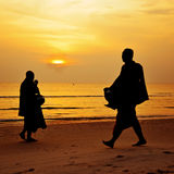 Silhouette of monks walk on the beach. In every morning , Huahin , Thailand Stock Image