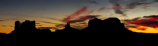 Silhouette of Monument Valley at Sunset Stock Photography