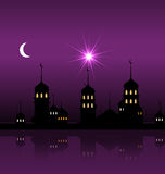 Silhouette of Mosque Against Night Sky with Crescent Moon Stock Photo