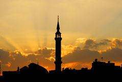 Silhouette of a mosque Stock Photos