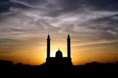 Silhouette of Mosque Below Cloudy Sky during Daytime Royalty Free Stock Photography