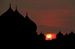 Silhouette of mosque city. View of a majestic sunset through a myriad of silhouette onion dome mosque stock photography