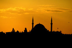 Silhouette of a mosque minaret at sunset Stock Photography