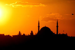 Silhouette of a mosque minaret at sunset Royalty Free Stock Photo