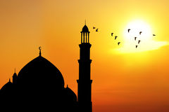 Silhouette of a Mosque during sunset. Silhouette of beautiful dome and minaret of mosque. shot at sunset Stock Photography