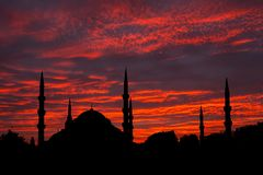Silhouette of mosque at sunset sky background Stock Image