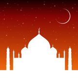 Silhouette mosque at sunset with stars and the crescent moon. Islam religion architecture. Stock Photos