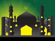 Silhouette of mosques in the moon night Stock Image