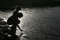 Silhouette of mother and child. On a pound stock photography