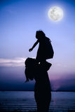 Silhouette of mother and child enjoying the view at riverside. Stock Photography
