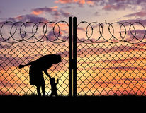 Silhouette mother with child refugees Royalty Free Stock Photo