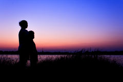 Silhouette mother and child Royalty Free Stock Images