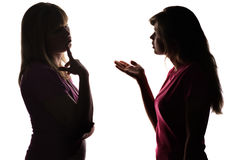 Silhouette mother and daughter dialogue, parent thinks what decision to take Royalty Free Stock Photography