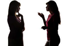 Silhouette mother and daughter dialogue. Silhouette on white isolated background mother and daughter dialogue, daughter asks mom, explains parent thinks what stock photos