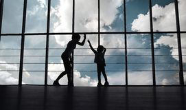 Silhouette of mother and daughter in the gym Royalty Free Stock Photo