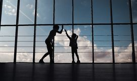 Silhouette of mother and daughter in the gym Royalty Free Stock Images
