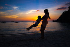 Silhouette of mother and little daughter on Royalty Free Stock Images