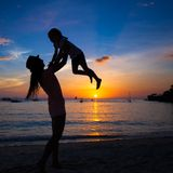 Silhouette of mother and little daughter playing Royalty Free Stock Image