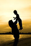 Silhouette of Mother playing with her son Royalty Free Stock Image