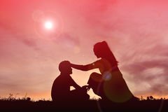 Silhouette mother and son holding heart shape Royalty Free Stock Image