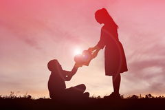 Silhouette mother and son holding heart shape Royalty Free Stock Images