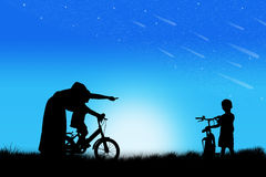 Silhouette of Mother teaching son biking Royalty Free Stock Photography