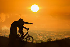Silhouette of Mother teaching son biking Stock Photography